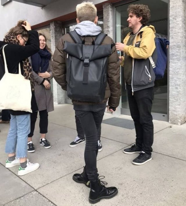 People Standing In Strange Poses